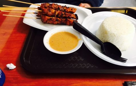 Sate ayam (pronounced sah-tay eye-ahm), or grilled chicken  skewers marinated in a base of sweet soy sauce and onion, served  with white rice and peanut sauce at Bali Sate House