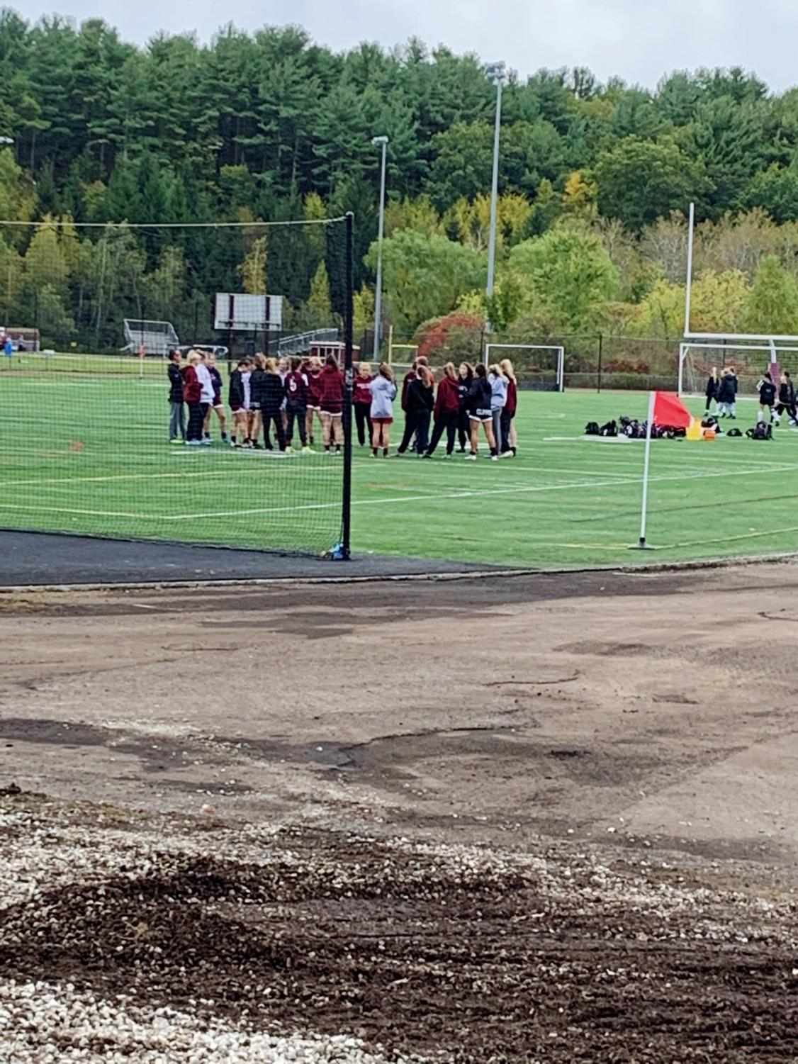 Portsmouth receiving a pep talk from coaches, Brint Shone and Hanna Strong, pre game