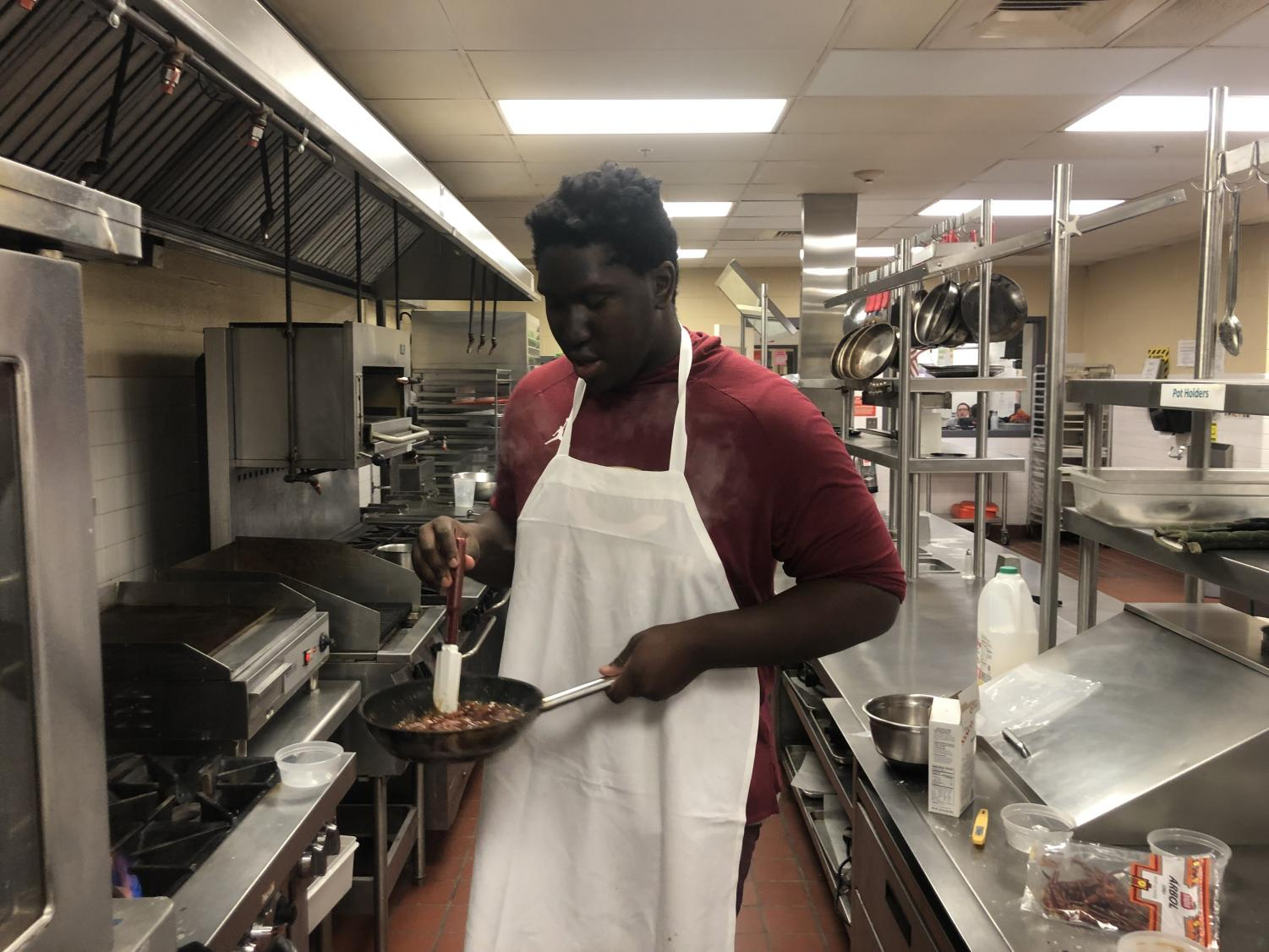 Tyrese Sterling testing out his recipe for this weeks Gourmet to go