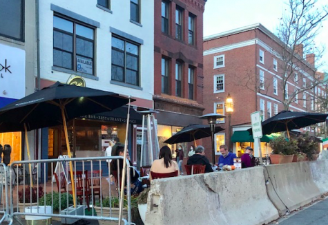 Restaurants using blocked off streets and heaters to create outdoor seating areas.